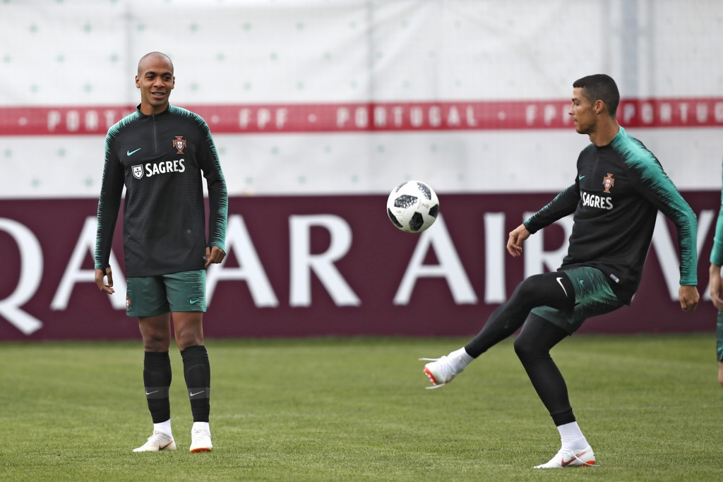 Portugal's Cristiano Ronaldo, right, plays the ball next to teammate Joao Mario during the training session of Portugal at the 2018 soccer World Cup i