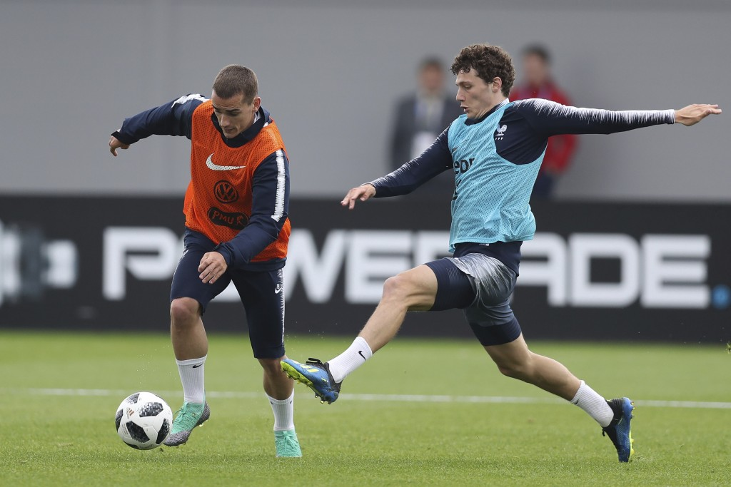 France's Antoine Griezmann controls the ball ahead Benjamin Pavard during a training session at the 2018 soccer World Cup in Glebovets, Russia, Tuesda