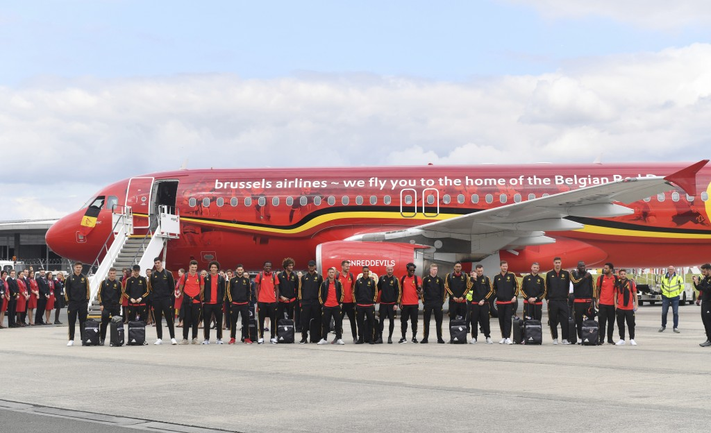 The Belgian national soccer team poses in front of their aircraft prior to departure in Brussels Wednesday