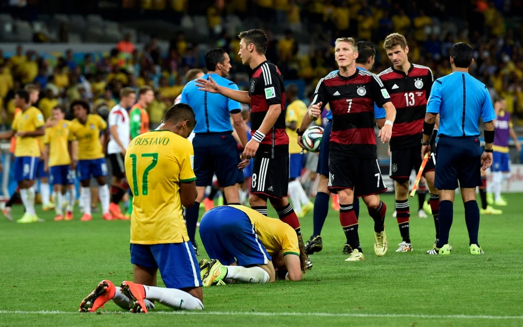 FILE - In this Tuesday, July 8, 2014 file photo, Brazil players sink to their knees after the team lost 7-1 against Germany in the World Cup semifinal
