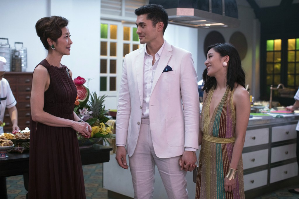 "This image released by Warner Bros. Pictures shows, from left, Michelle Yeoh, Henry Golding and Constance Wu in a scene from ""Crazy Rich Asians,"" in t"