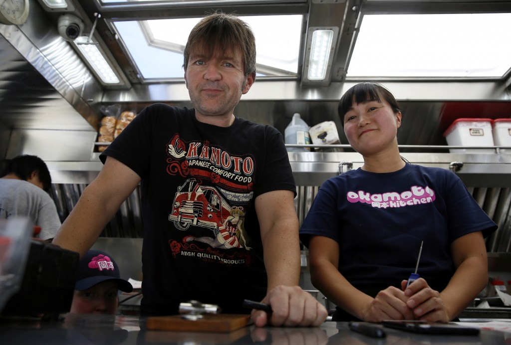 In this Friday, June 8, 2018, photo Gerald Abraham and Chizuru Abraham, who started their Japanese food truck in Los Angeles three years ago, pose for