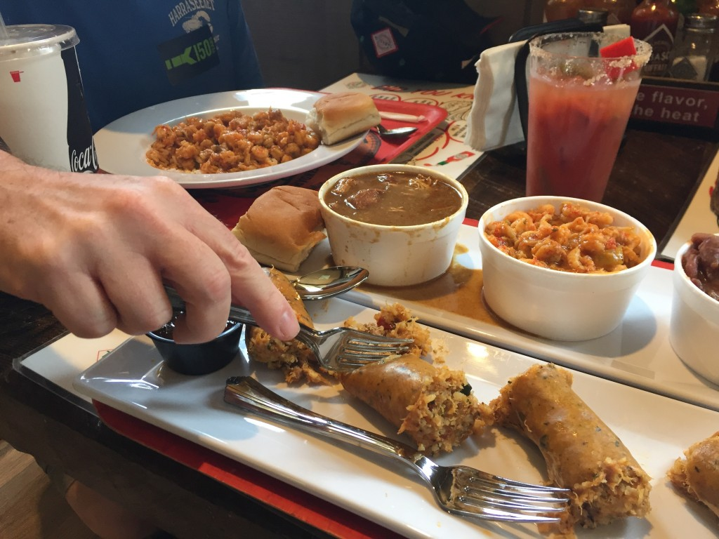 This June 4, 2018 photo shows boudin sausage, crawfish etouffee and other Cajun-style food served at a cafe on Avery Island, Louisiana, as part of a c