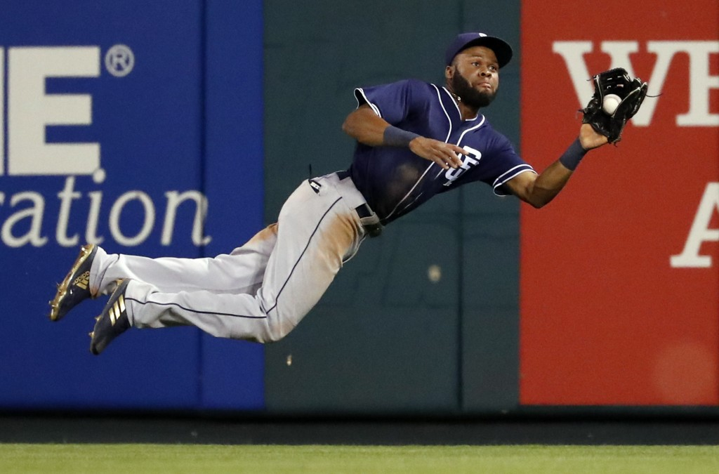 San Diego Padres center fielder Manuel Margot dives for and catches a fly ball by St. Louis Cardinals' Tommy Pham during the eighth inning of a baseba