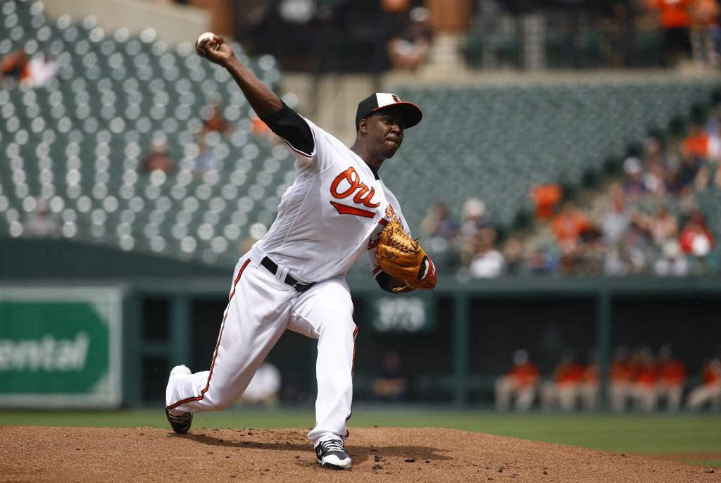 Baltimore Orioles starting pitcher Yefry Ramirez throws to the Boston Red Sox in the first inning of a baseball game, Wednesday, June 13, 2018, in Bal