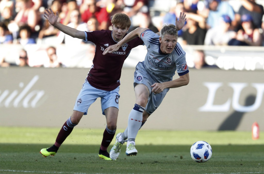 Chicago Fire midfielder Bastian Schweinsteiger, front, drives past Colorado Rapids midfielder Johan Blomberg during the first half of an MLS soccer ma