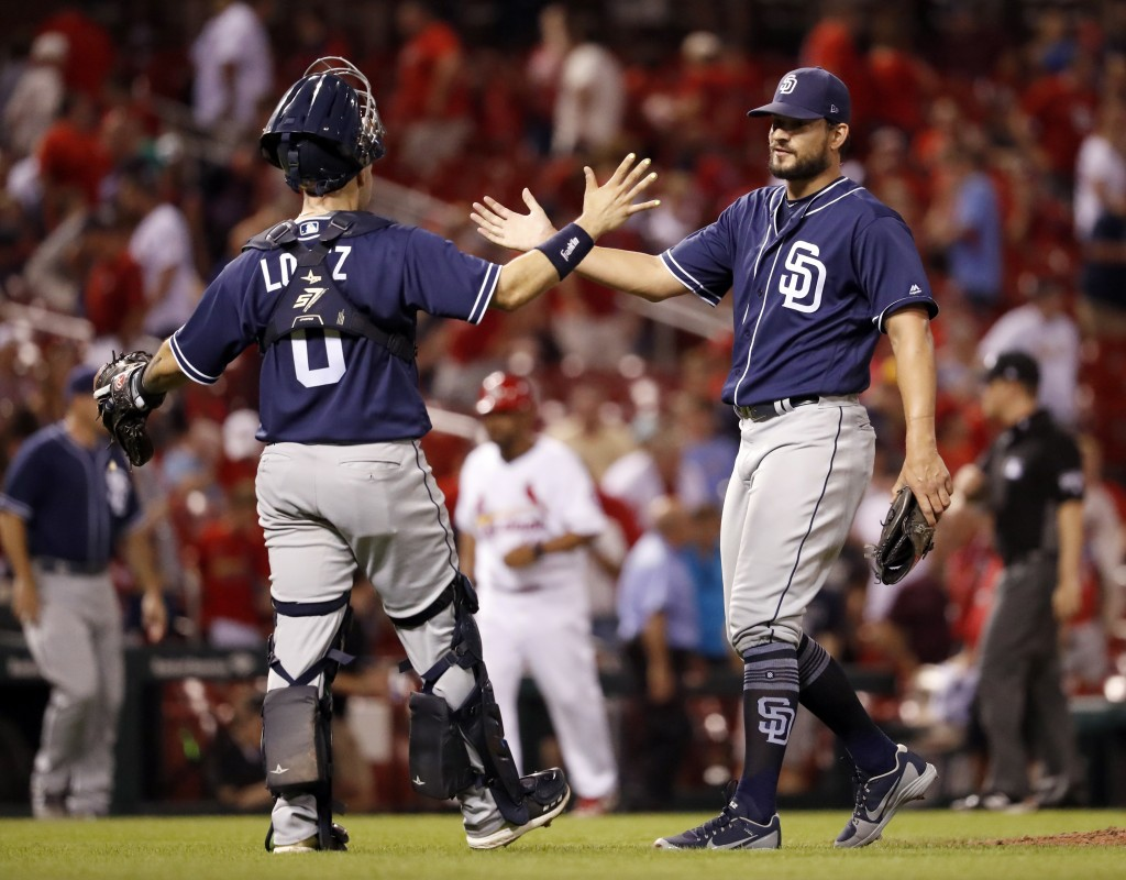 San Diego Padres relief pitcher Brad Hand, right, and catcher Raffy Lopez celebrate following a baseball game against the St. Louis Cardinals on Wedne