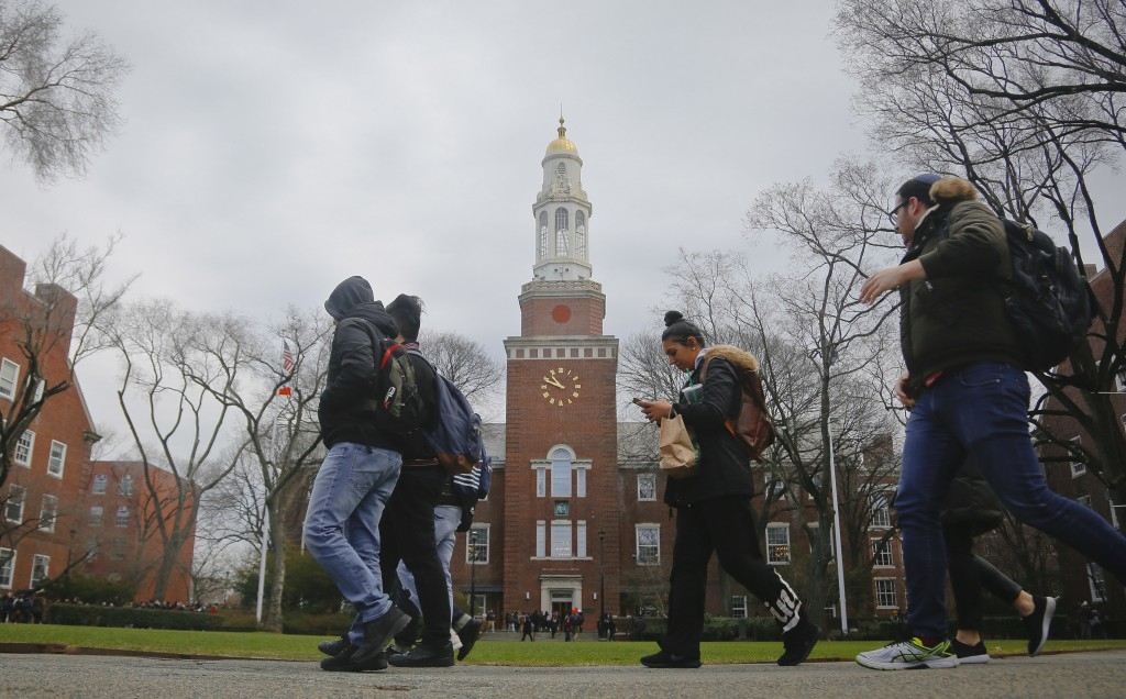 FILE - In this Feb. 1, 2017, file photo, Brooklyn College students walk between classes on campus in New York. More than two-thirds of college student