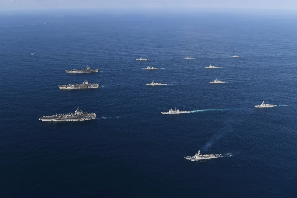FILE - In this Nov. 12, 2017, file photo provided by South Korea Defense Ministry, three U.S. aircraft carriers USS Nimitz, left top, USS Ronald Reaga...