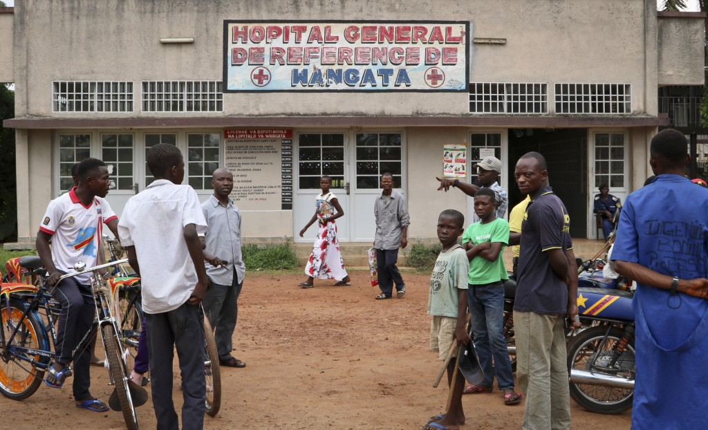 In this photo taken Thursday, May 31, 2018, motorcycle and cycle taxis wait for passengers outside Wangata hospital in the town of Mbandaka, Congo. Hu