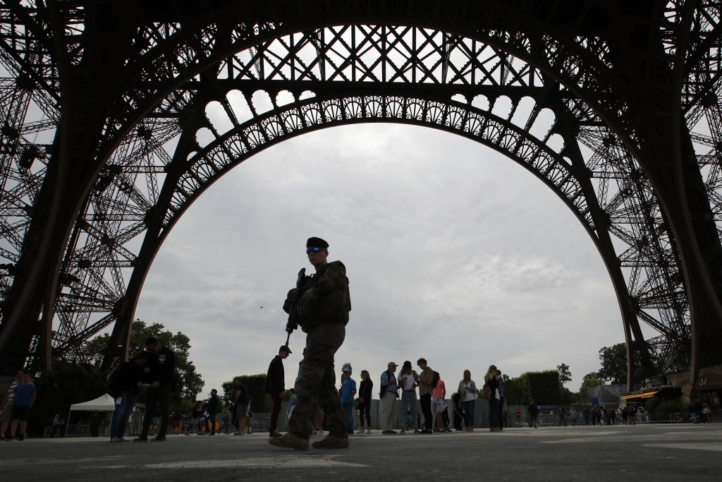 French soldier patrols during a press visit of the new security barriers under construction around the Eiffel Tower in Paris, France, Thursday, June 1