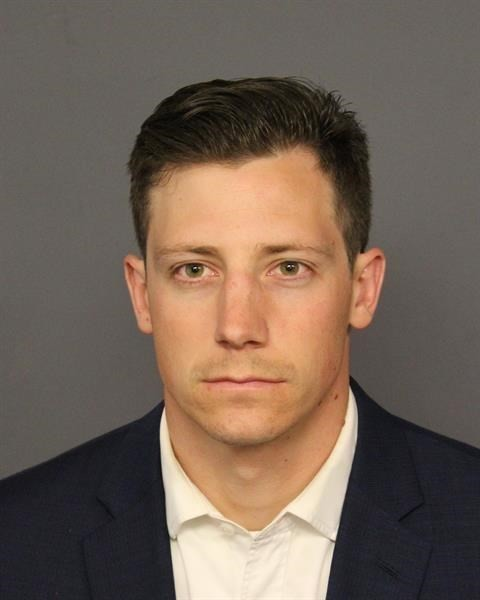 FILE--This undated file photo provided by the Denver Police Department shows Chase Bishop. The off-duty FBI agent who investigators say accidentally f