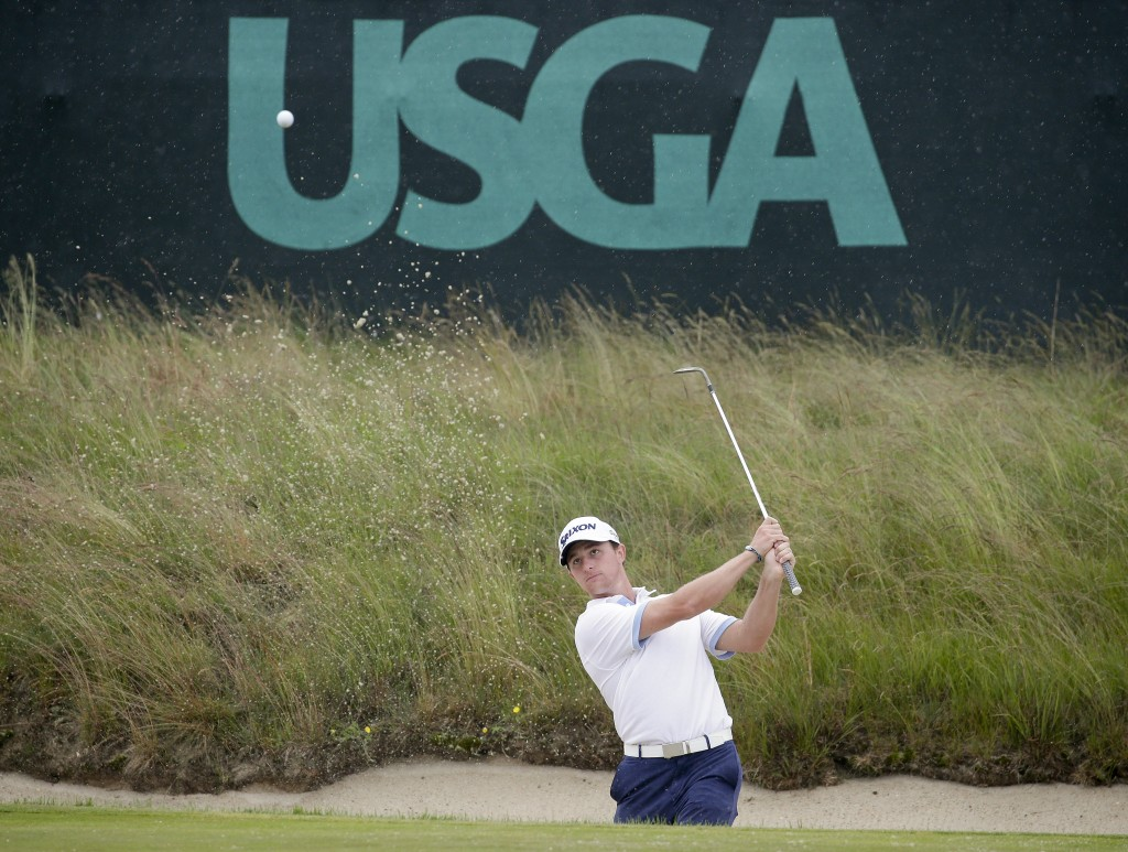 Cole Miller hits out of a bunker during a practice round for the U.S. Open Golf Championship, Wednesday, June 13, 2018, in Southampton, N.Y. (AP Photo