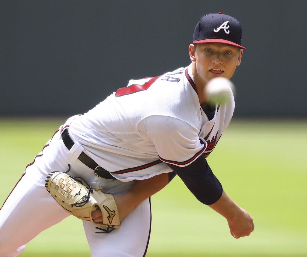 Atlanta Braves pitcher Mike Soroka throws against the New York Mets during the first inning of a baseball game Wednesday, June 13, 2018, in Atlanta. (