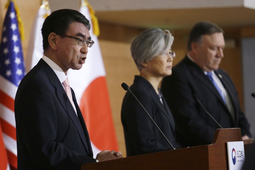 Japanese Foreign Minister Taro Kono, left, speaks as U.S. Secretary of State Mike Pompeo, right, and South Korean Foreign Minister Kang Kyung-wha list...
