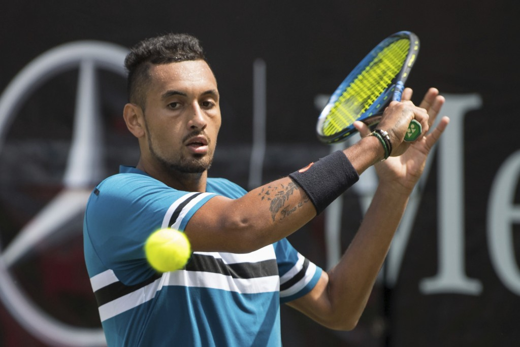 Nick Kyrgios returns the ball to Maximilian Marterer during their match at the ATP Mercedes Cup tournament in Stuttgart, Germany, Thursday, June 14, 2