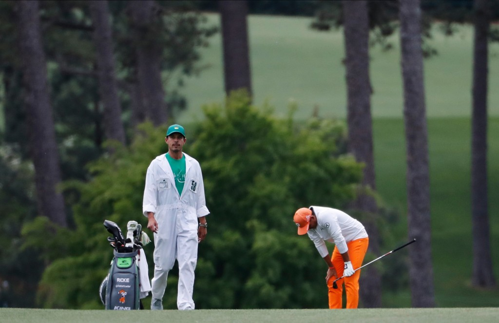 FILE - In this April 8, 2018, file photo, Rickie Fowler reacts to a shot on the 17th hole during the fourth round at the Masters golf tournament in Au