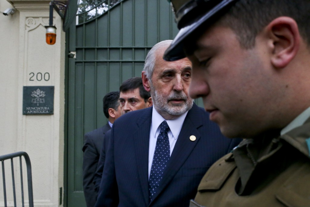 Chile's General Attorney Jorge Abbott, center, leaves the Apostolic Nunciature after meeting with Archbishop Charles Scicluna in Santiago, Chile, Wedn