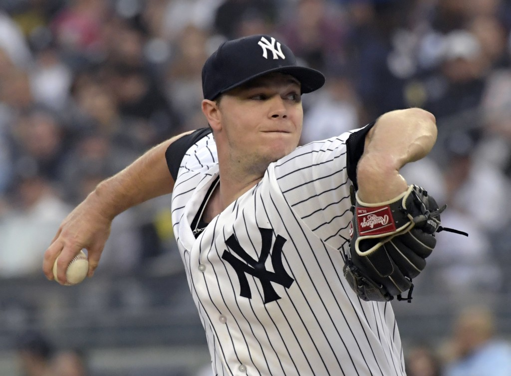 New York Yankees starting pitcher Sonny Gray winds up during the first inning of the team's baseball game against the Washington Nationals on Wednesda