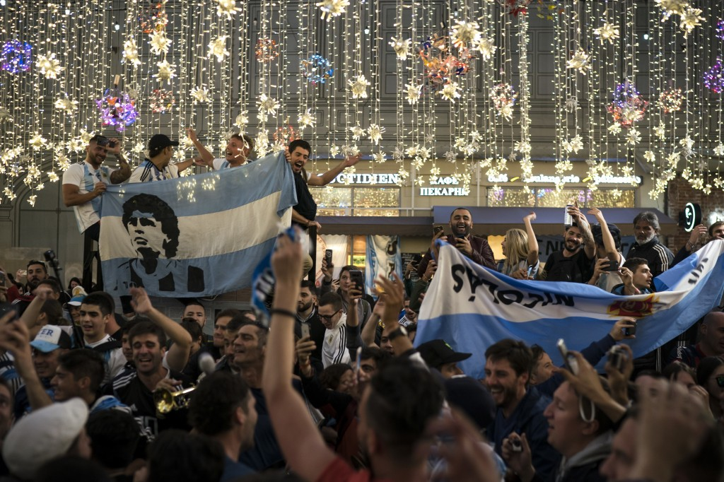 Argentina's soccer fans chant as they gather on Nikolskaya Street ahead of the 2018 soccer World Cup in Moscow, Russia, Wednesday, June 13, 2018. Fans