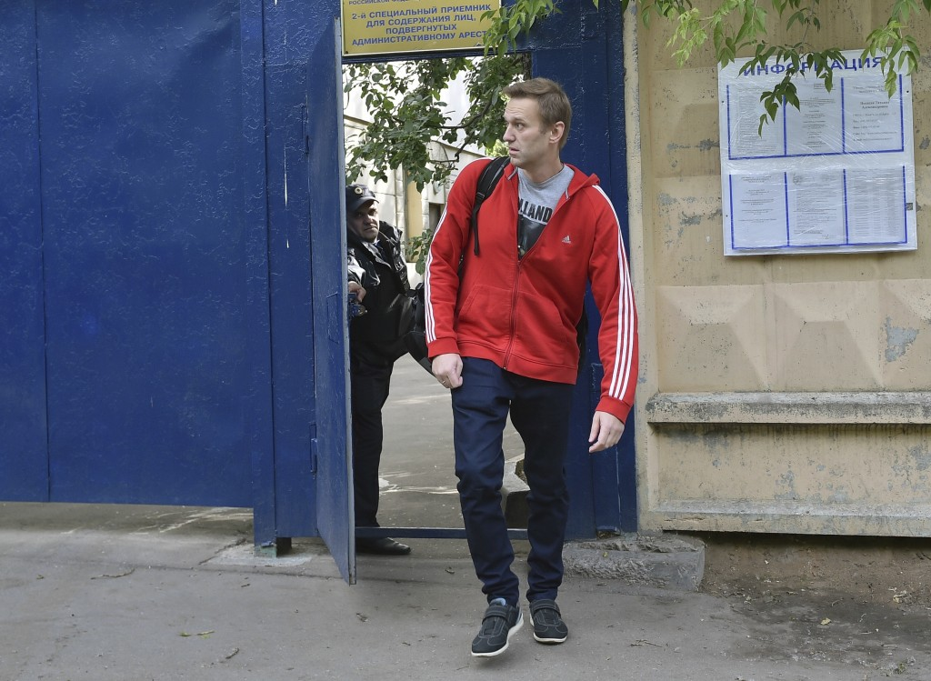 Russian opposition activist Alexei Navalny leaves a detention center in Moscow, Russia, Thursday, June 14, 2018. Navalny has been sentenced to 30 days