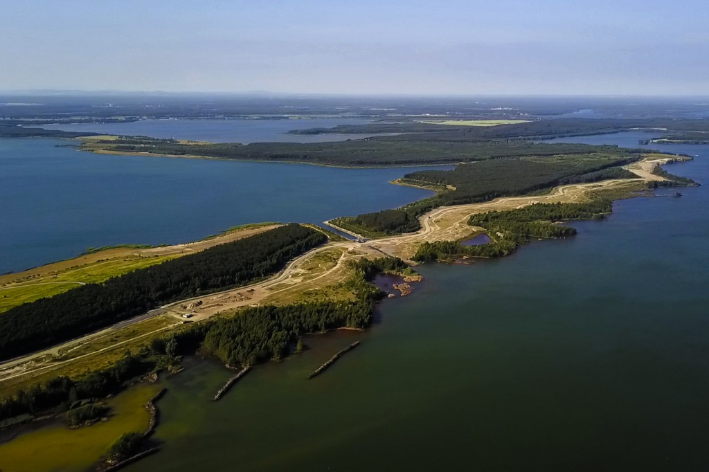 In this Wednesday, June 6, 2018 photo, the lake Sedlitzer See, a former lignite coal pit flooded with water in the Lusatia (Lausitz) area in Germany T