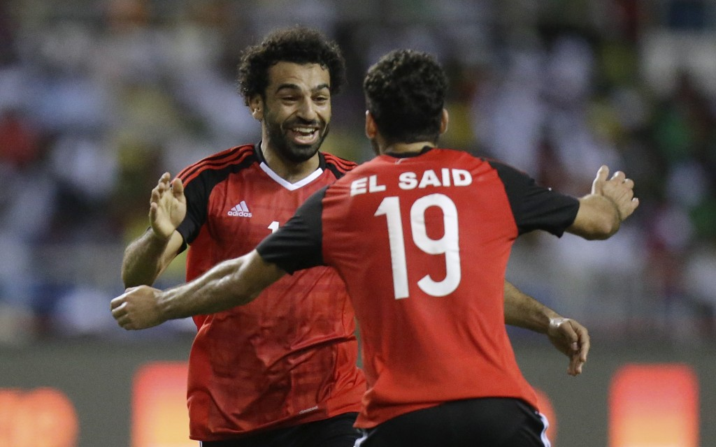 FILE - In this Feb. 1, 2017 fiel photo Egypt's Mohamed Salah, left, celebrates after scoring the opening goal during the African Cup of Nations semifi
