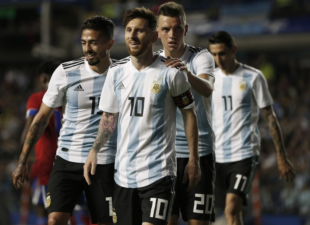 FILE - In this May 29, 2018 file photo Argentina's Manuel Lanzini, left, Giovanni Lo Celso, second right, and Angel Di Maria, right, congratulate team