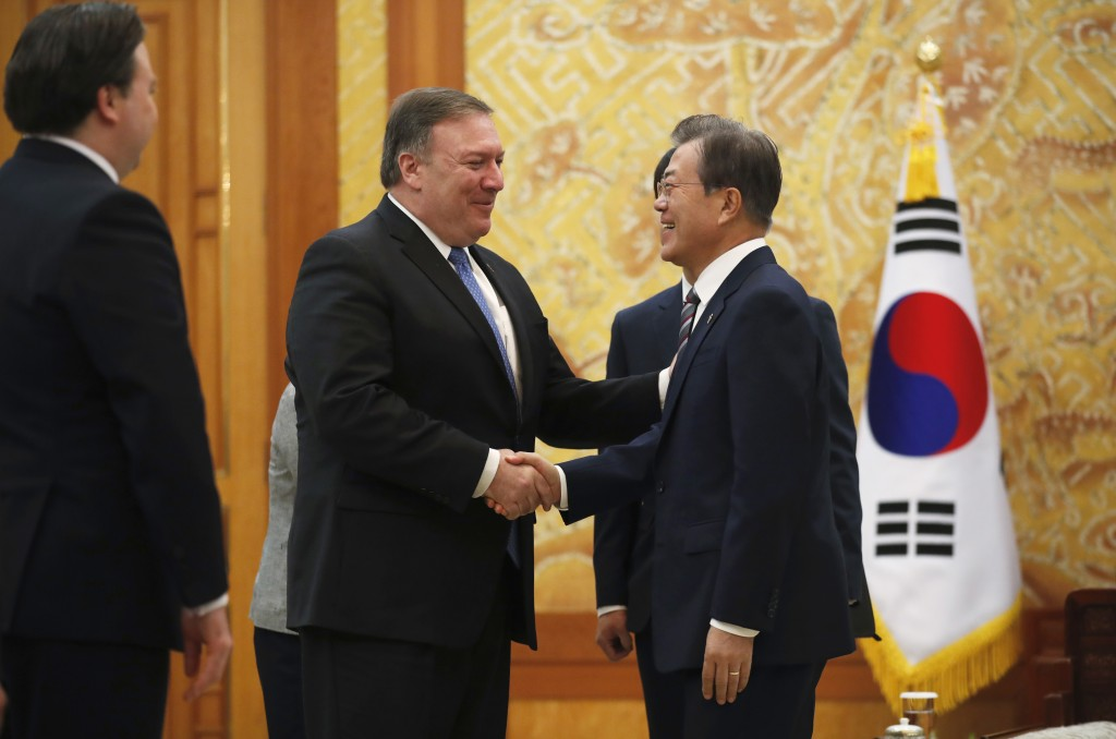 U.S. Secretary of State Mike Pompeo, second from left, shakes hands with South Korean President Moon Jae-in during a bilateral meeting at the presiden...