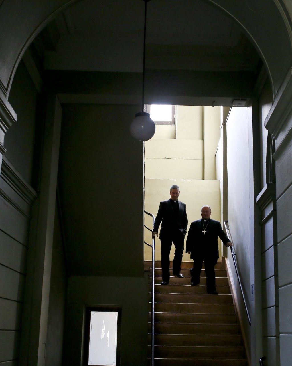 Archbishop Charles Scicluna, right, and Spanish Monsignor Jordi Bertomeuof, walk down a set of stairs prior a press conference at the Catholic Univers
