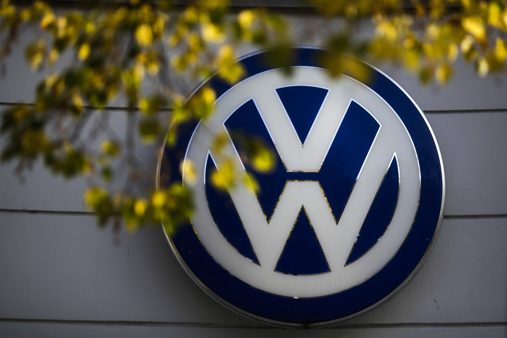 FILE - In this Oct. 5, 2015, file photo, the VW sign of Germany's Volkswagen car company is displayed at the building of a company's retailer in Berli