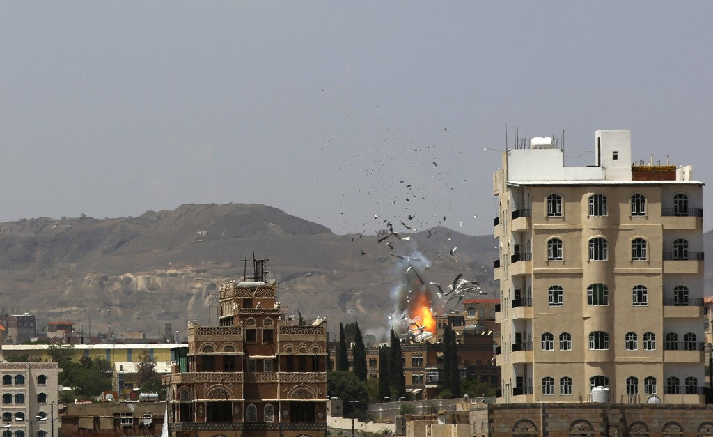 FILE - In this Sept. 14, 2015, file photo, debris and smoke rise after a Saudi-led airstrike hits an army base in Sanaa, Yemen. Yemen's yearslong war