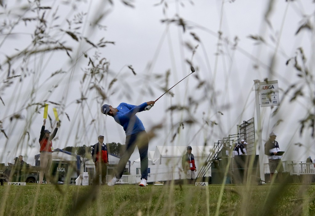 Shubhankar Sharma, of India, hits off the ninth tee during a practice round for the U.S. Open Golf Championship, Wednesday, June 13, 2018, in Southamp