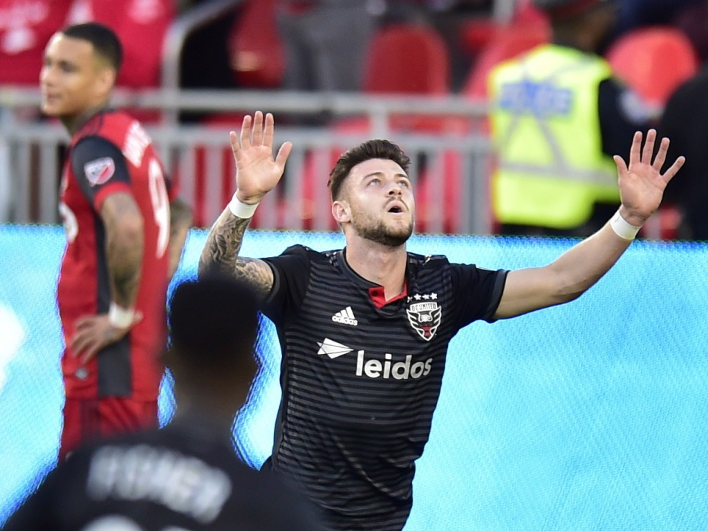 D.C. United forward Paul Arriola celebrates his goal against Toronto FC during the first half of an MLS soccer match Wednesday, June 13, 2018, in Toro