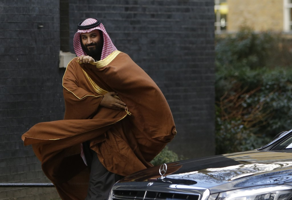 FILE - In this March 7, 2018, file photo, Saudi Arabia's Crown Prince Mohammed bin Salman walks to greet Britain's Prime Minister Theresa May outside