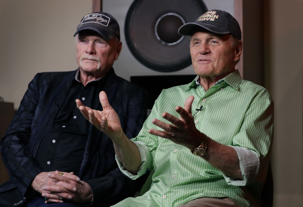 In this photo taken on Wednesday, June 13, 2018, Beach Boys musicians Mike Love, left, and Bruce Johnston, right, during an interview with Associated