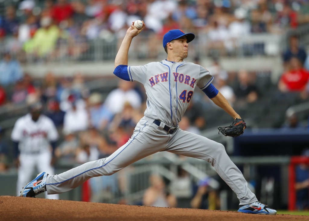 New York Mets starting pitcher Jacob deGrom (48) delivers in the first inning of a baseball game against the Atlanta Braves, Wednesday, June 13, 2018,
