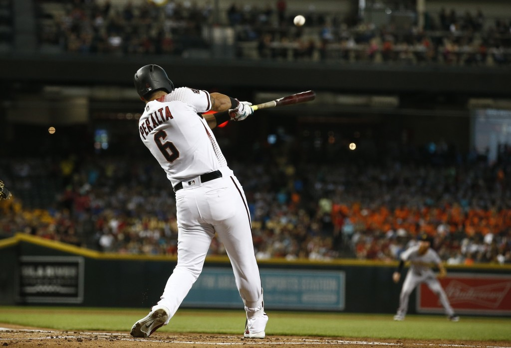 Arizona Diamondbacks' David Peralta connects for a two-run home run against the Pittsburgh Pirates during the first inning of a baseball game Wednesda
