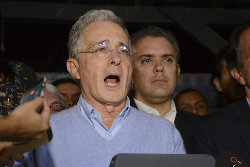 FILE - In this Oct. 2, 2016 file photo, opposition Senator and former President Alvaro Uribe reads a statement at his house in Rionegro, Colombia. Aft