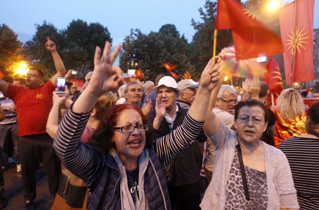 People protest against the change of the country's constitutional name in front of the Parliament building in Skopje, Macedonia, Wednesday, June 13, 2