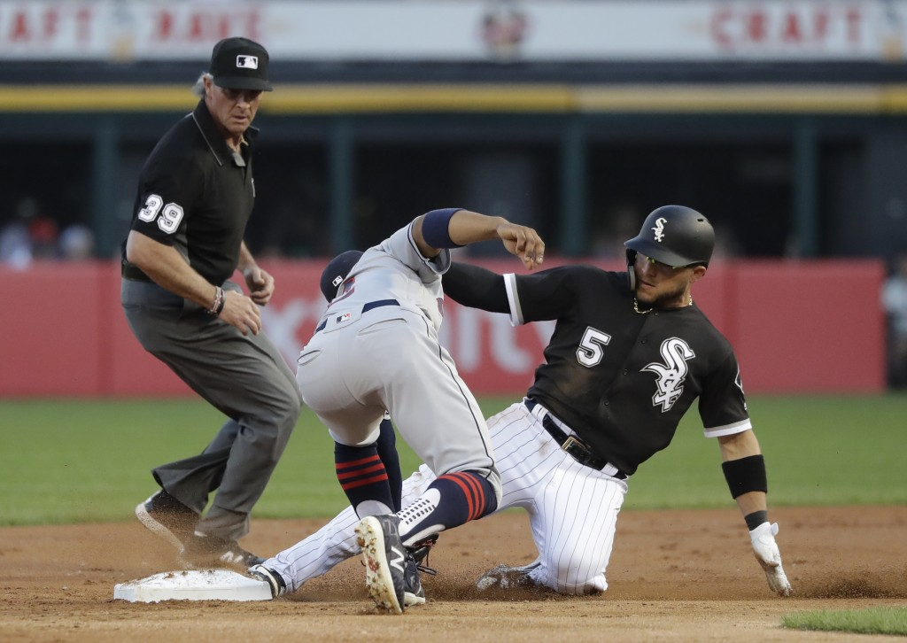 Chicago White Sox's Yolmer Sanchez (5) steals second on a throw from Cleveland Indians catcher Roberto Perez to shortstop Francisco Lindor, as second