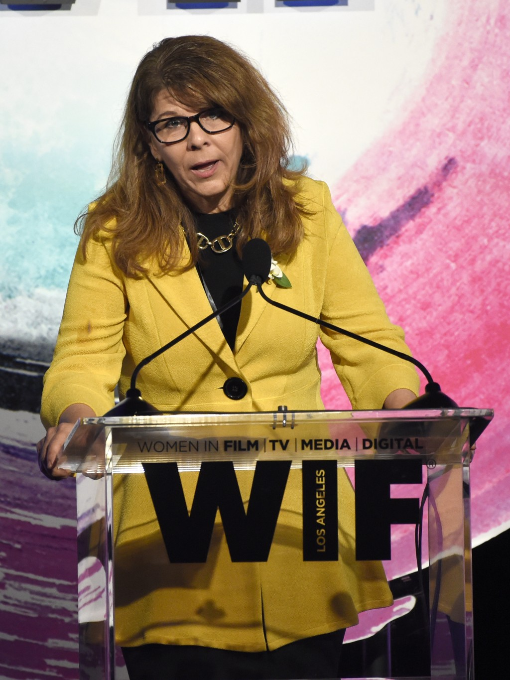 Stacey L. Smith speaks at the Women In Film Crystal and Lucy Awards at the Beverly Hilton Hotel on Wednesday, June 13, 2018, in Beverly Hills, Calif.