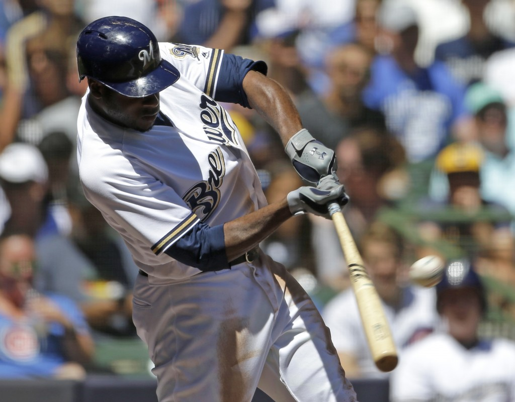 Milwaukee Brewers' Lorenzo Cain hits a solo home run during the third inning of a baseball game against the Chicago Cubs, Wednesday, June 13, 2018, in