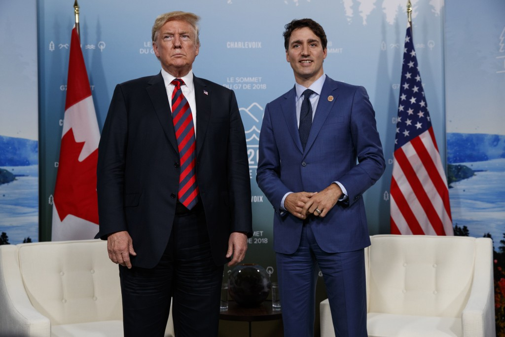 FILE - In this June 8, 2018 file photo, U.S. President Donald Trump meets with Canadian Prime Minister Justin Trudeau at the G-7 summit in Charlevoix,