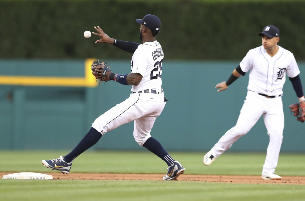 Detroit Tigers second baseman Niko Goodrum bare-hands the relay from shortstop Jose Iglesias, right, for a force on Minnesota Twins' Bobby Wilson on a