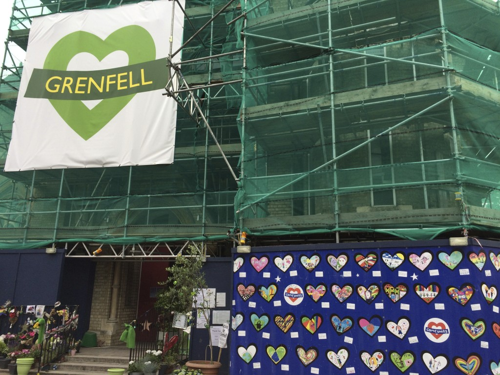 Tributes are left at Notting Hill Methodist Church, Thursday, June 14, 2018, in support of those affected by the massive fire in Grenfell Tower in Lon