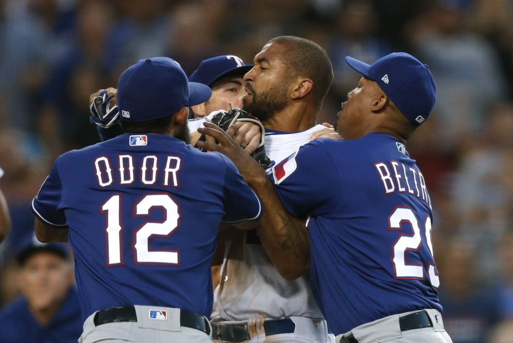 Texas Rangers' Rougned Odor and Adrian Beltre restrain Los Angeles Dodgers' Matt Kemp, center, as Kemp scuffled with Rangers catcher Robinson Chirinos