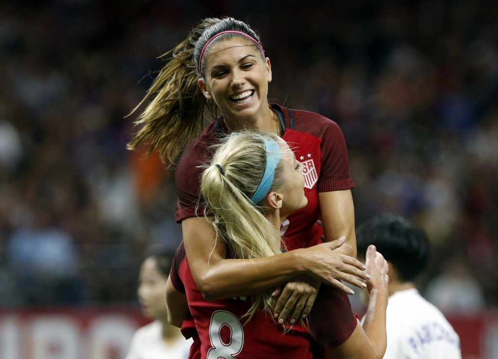 FILE - In this Oct. 19, 2017, file photo, U. S. midfielder Julie Ertz (8) celebrates her header goal with forward Alex Morgan, rear, in the first half