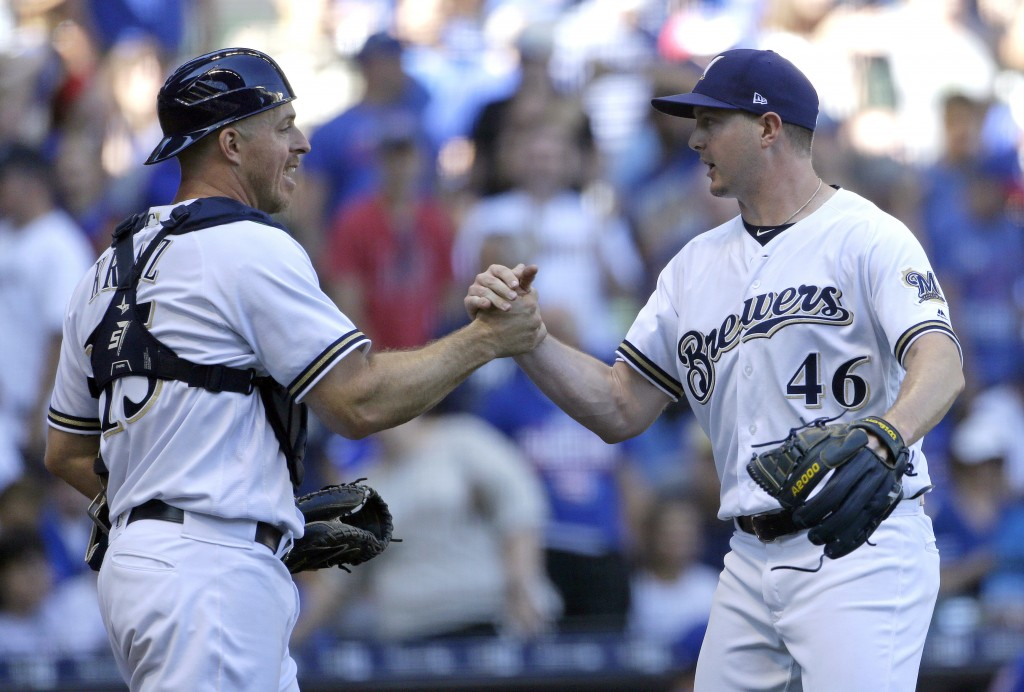 Milwaukee Brewers' Corey Knebel (46) is congratulated by Erik Kratz after recording a save after a baseball game against the Chicago Cubs Wednesday, J