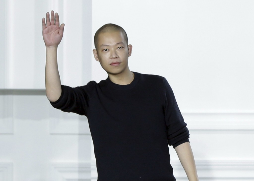 FILE - In this Feb. 13, 2015 file photo, designer Jason Wu acknowledges audience applause after his Fall 2015 collection was modeled during Fashion We